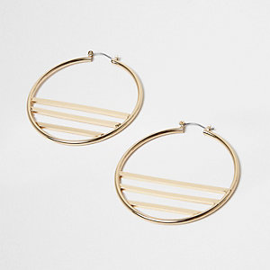 Gold tone lined hoop earrings