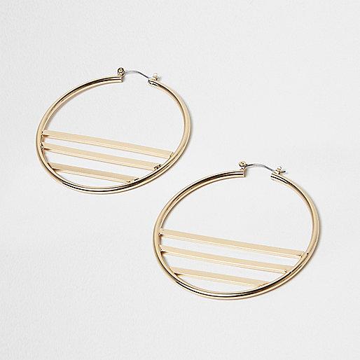 Gold tone lined hoop earrings