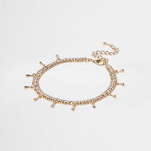 Bracelet de cheville doré orné