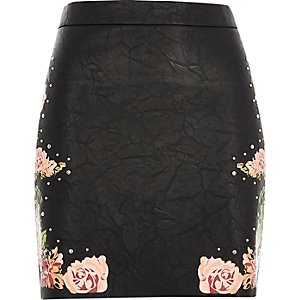 Black faux leather floral mini skirt