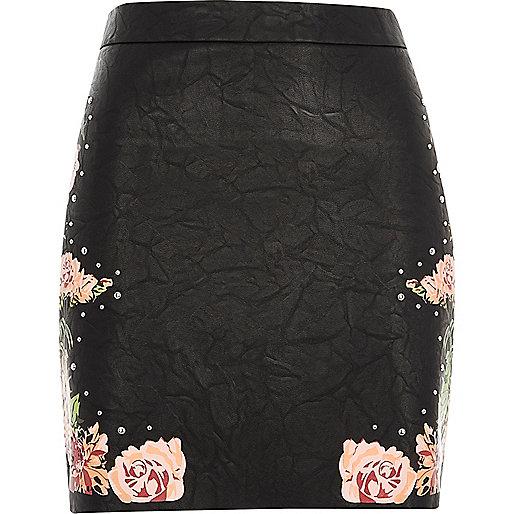 Black faux leather floral mini skirt