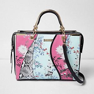 Roze-lichtblauwe tas met bloemenprint en golvend detail