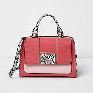 Roze handtas met slangenprint