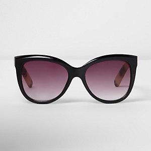 Zwarte en goudkleurige cat-eye-zonnebril