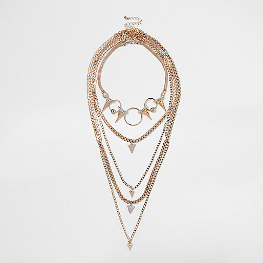 Gold tone spike layer necklace