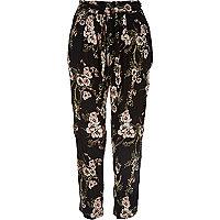 Zwarte ruimvallende broek met bloemenprint