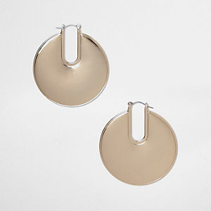 Gold tone disc hoop earrings