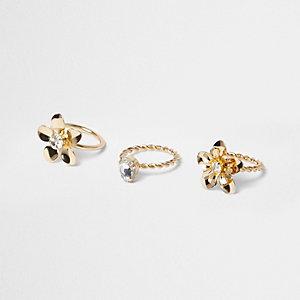 Set goudkleurige ringen met bloemetje