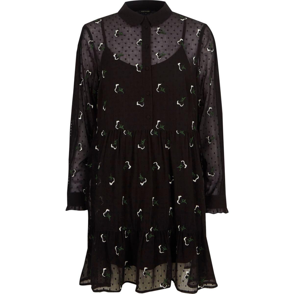 Zwarte gebloemde jurk met ruches aan de zoom
