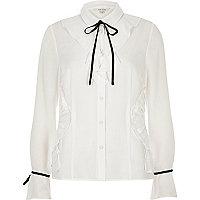 White long sleeve tie neck shirt