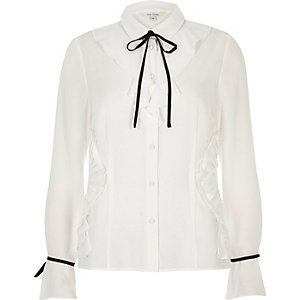 White long sleeve tie neck shirt