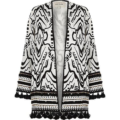 Zwart-witte kimono met kralenborduursel en kwastjes aan de zoom