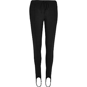 Zwarte legging met bandjes onder de voet