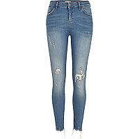 Amelie - blauwe superskinny jeans met verweerde zoom