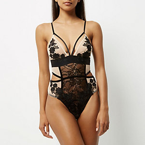 Nude and black lace lingerie bodysuit