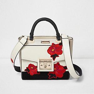 Witte geborduurde handtas met bloemenprint