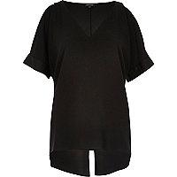 Schwarze Bluse mit Schulterausschnitten