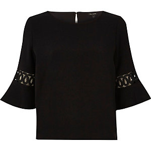 Black cut out flute sleeve top