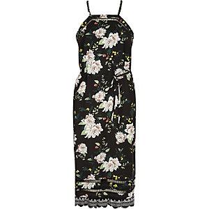 Robe caraco mi-longue en dentelle façon résille motif fleuri noire