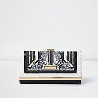 Porte-monnaie noir et blanc à fleurs et fermoir clip