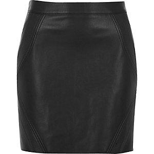 Mini-jupe noire avec empiècements imprimé serpent