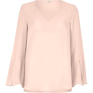 Light pink flared sleeve top
