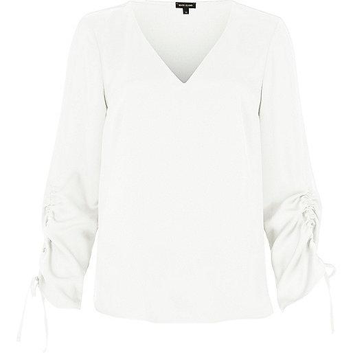 Cream gathered sleeve top