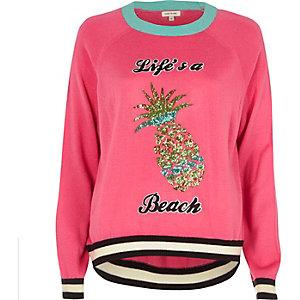 Pull en maille rose avec ananas en sequins