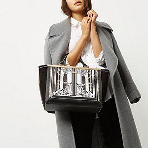 Zwart-witte handtas met sjaalprint