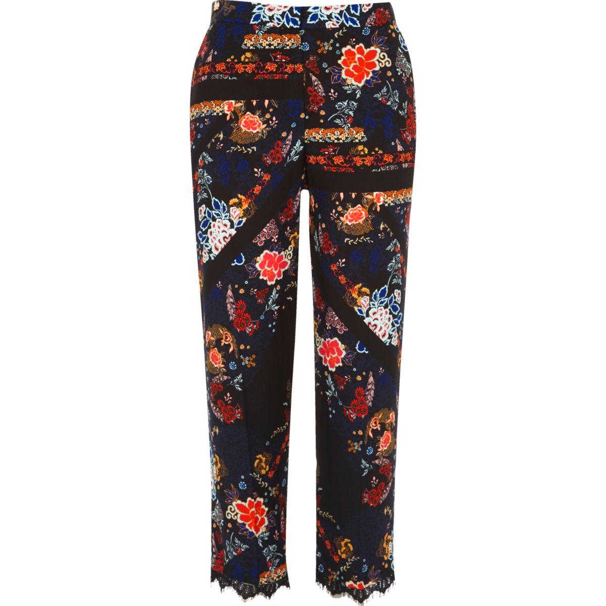 Pantalon à fleurs noir avec ourlet en dentelle