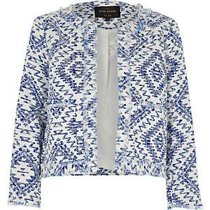 Veste bleue à franges et imprimé aztèque
