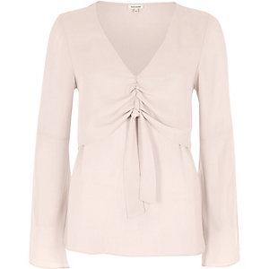 Pink layered tie front blouse