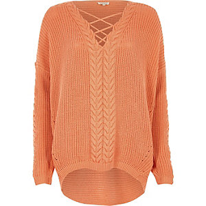 Coral cable knit lace-up front sweater