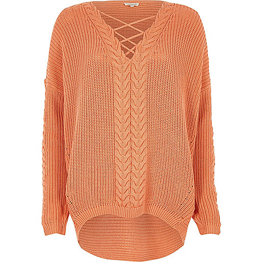 Coral cable knit lace-up front jumper