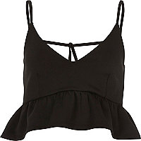 Black peplum cross back cami crop top