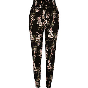 Black floral print tapered pants