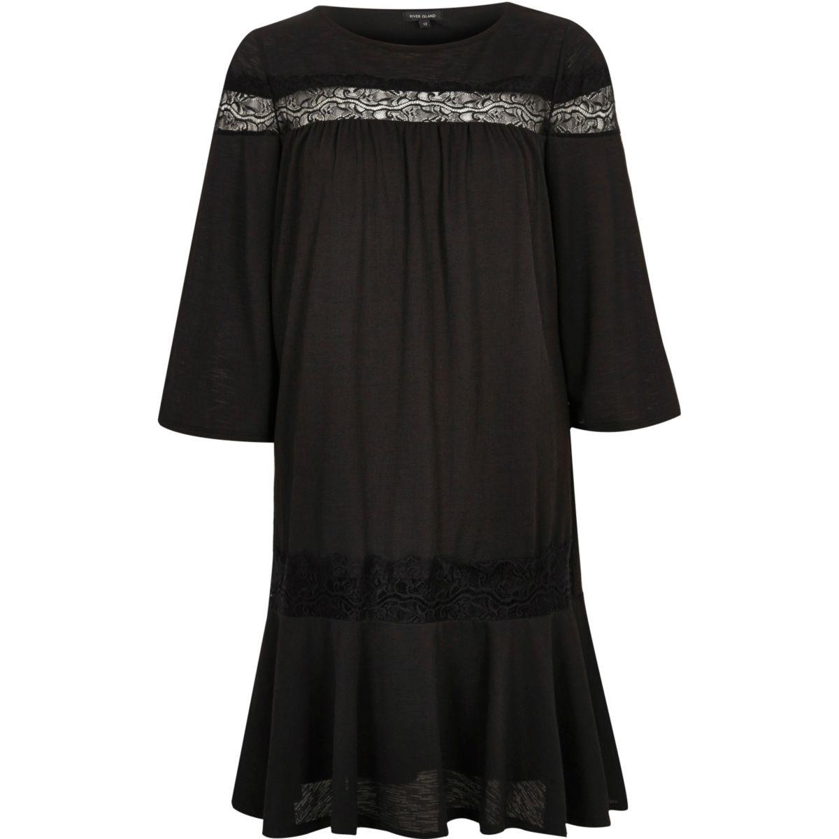 Robe en dentelle noire à manches longues et smocks
