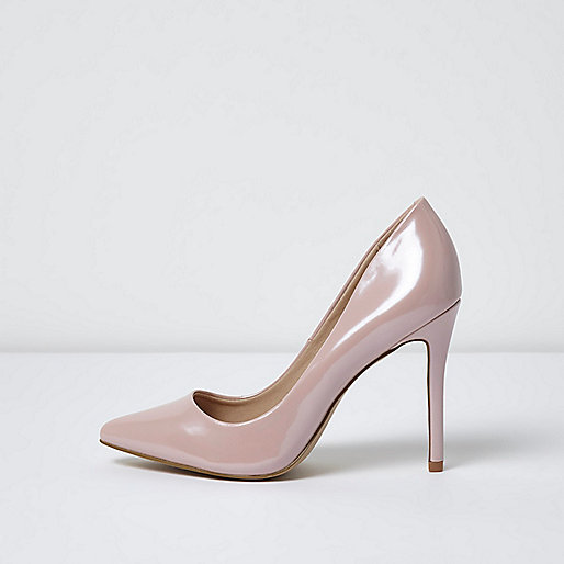 Light pink patent pumps