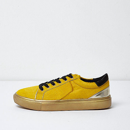Yellow pony hair platform trainers