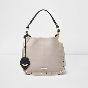 Beige studded slouch handbag
