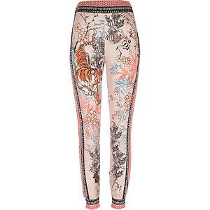 Roze jersey pyjamabroek met tijgerprint