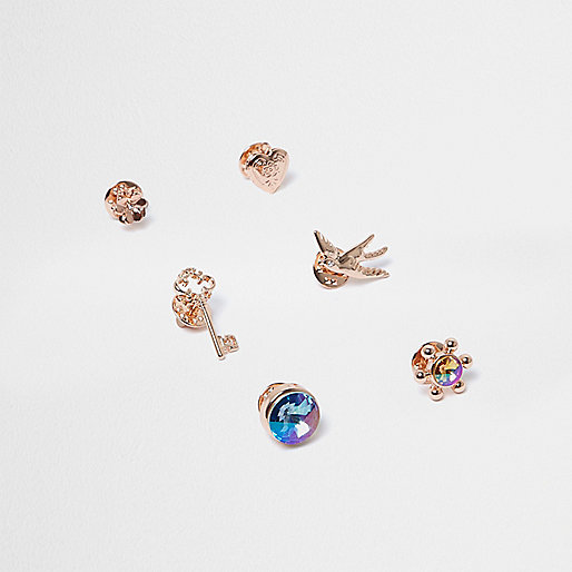 Rose gold tone badge set