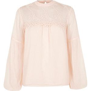 Light pink cutwork bell sleeve blouse
