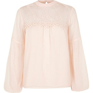 Light pink cutwork bell sleeve blouse