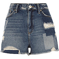 Mid blue wash distressed patch denim shorts