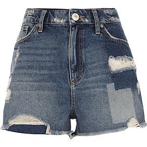 Mid blue wash distressed patch denim shorts