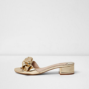 Gold metallic bow block heel mules