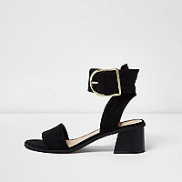 Black oversized buckle sandals