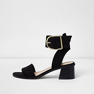 Black oversized buckle leather sandals