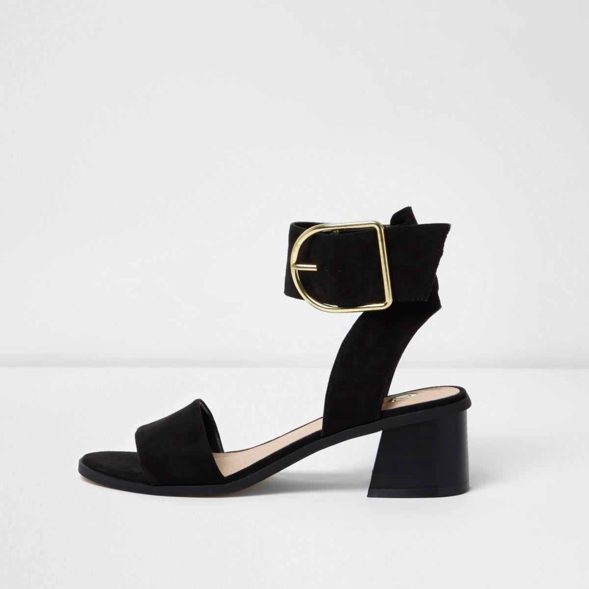 Sandales noires à grosses boucles